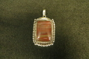 Navajo Made Petrified Wood and Sterling Silver pendant