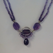 Amethyst is said to bring healing and peace. It is a meditation stone. Also it is refered to as the sobriety stone.
